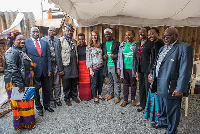 Wambua (in green) smiles for the camera alongside Melinda Gates, Babatunde Osotimehin, Jhpiego's Kenya Country Director Mildred Mudany, and family planning colleagues.